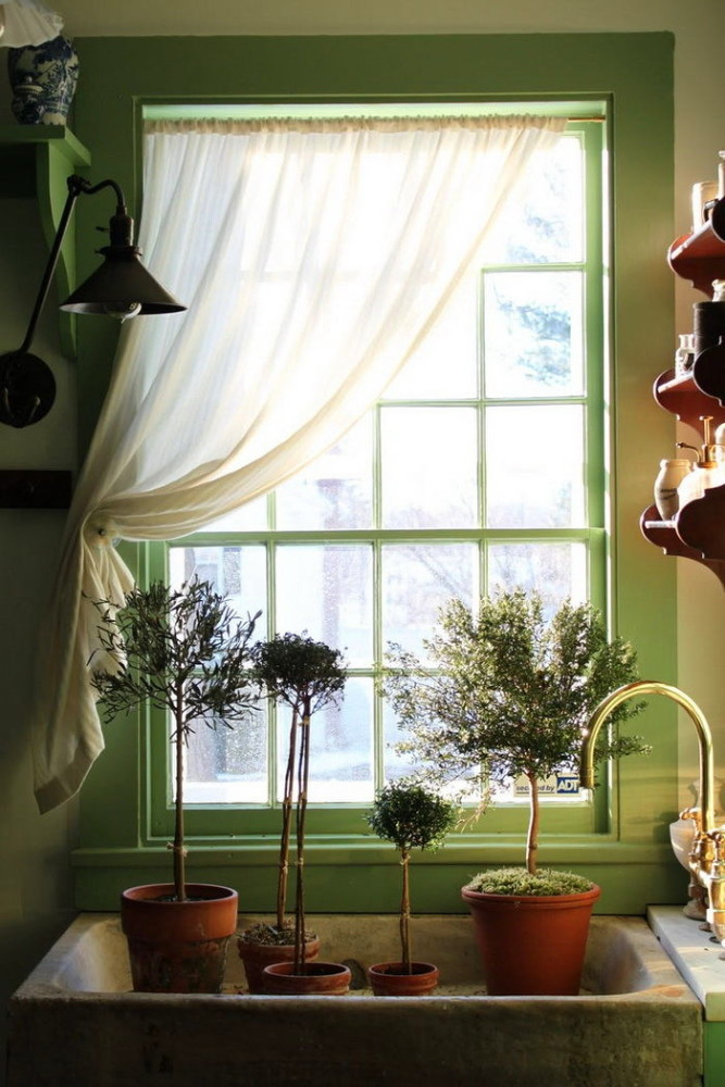 Кухня в цветах: зеленый, светло-серый, белый, темно-зеленый, бежевый. Кухня в стиле классика.
