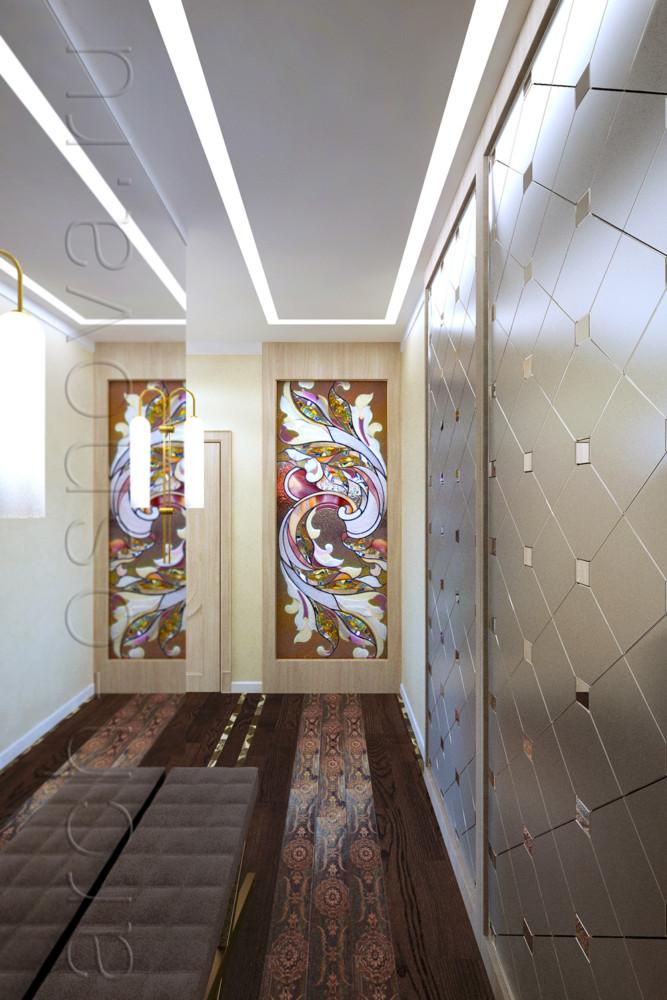 Небольшое пространство прихожей зрительно увеличили, расположив на одной стене большую зеркальную панель. Эффектное витражное панно располагается напротив входа в квартиру и становится изысканным композиционным центром пространства. Художественный витраж пропускает в закрытую прихожую естественное освещение со стороны большого окна в спальне и наполняет пространство красивой игрой световых бликов.