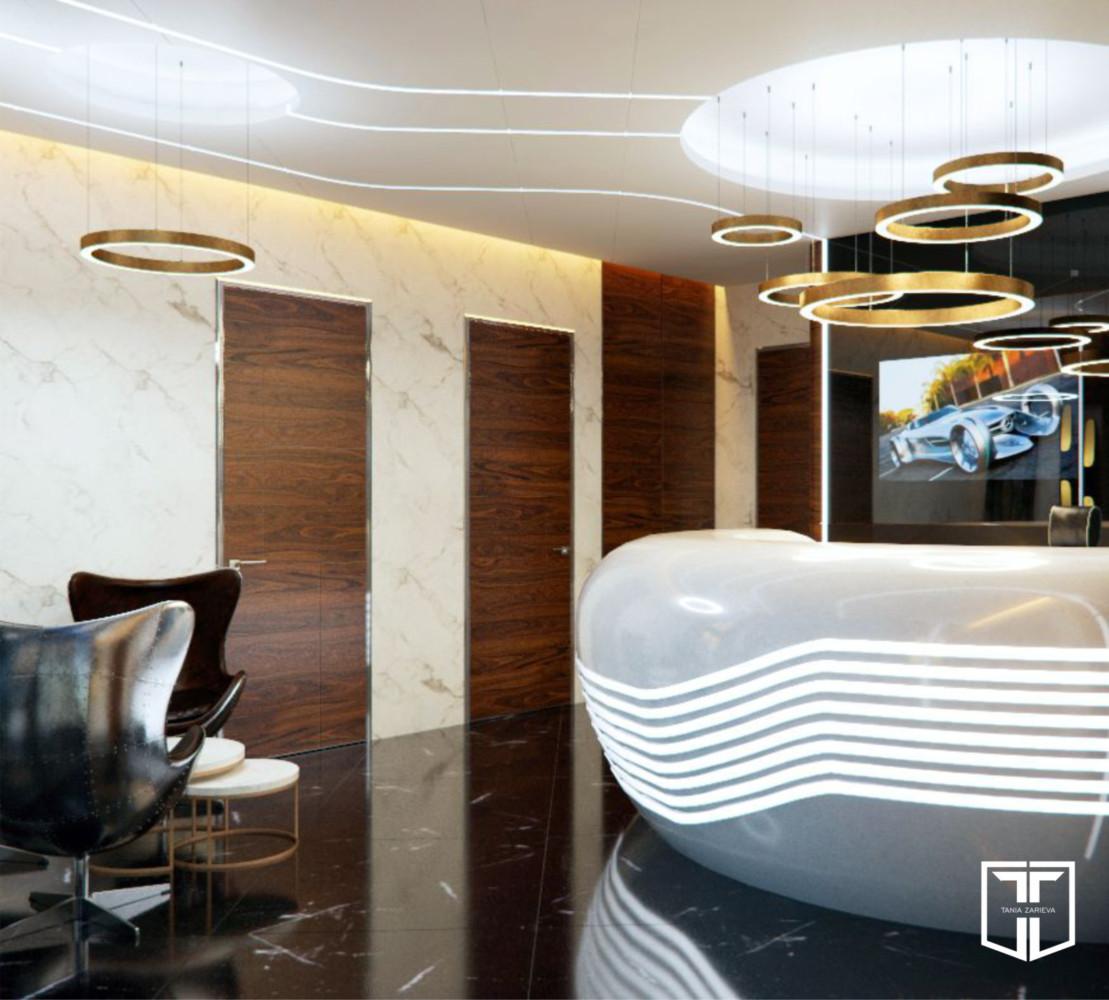 Фактуры помещения — шпон американского ореха на дверях и корпусной мебели, натуральный мрамор на стенах и полах.