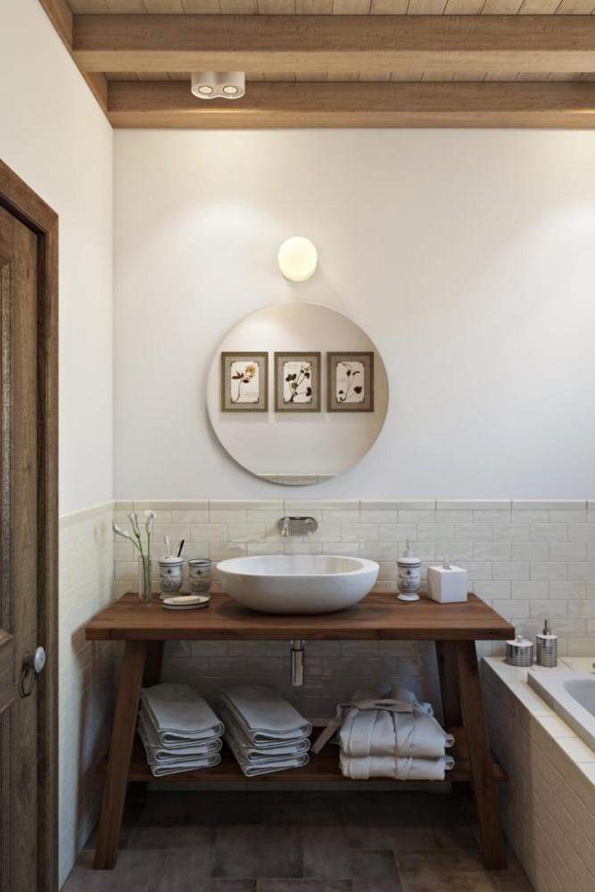 """Выдержанная, стильная и чрезмерно комфортная ванная комната. Плитка """"кабанчик"""" ручной работы, деревянная столешница и милые полочки. Потолок имитирует деревянное перекрытие, лежа в ванной можно подробно его лицезреть"""