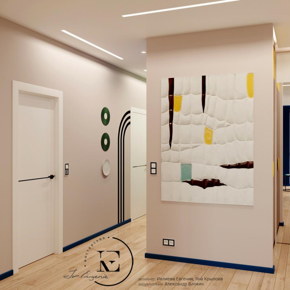 Холл выполнен в светлых тонах. На белом фоне хорошо выделяется черная графика на стене, темная отделка дверей и нежный постер от дизайнера.